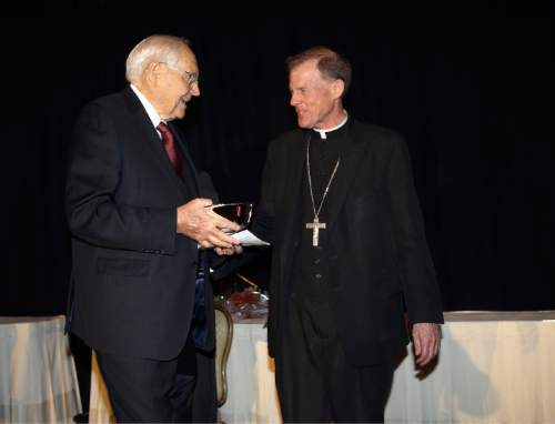 Courtesy  |  LDS Newsroom  Elder L. Tom Perry of the Quorum of the Twelve Apostles receives a humanitarian award from Bishop John C. Wester of the Catholic Diocese of Salt Lake City, November 6, 2014.
