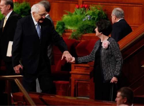 Courtesy  |  LDS Newsroom  Elder L. Tom Perry and his wife Barbara exit the Sunday morning session of the 185th Annual General Conference on April 5, 2015.