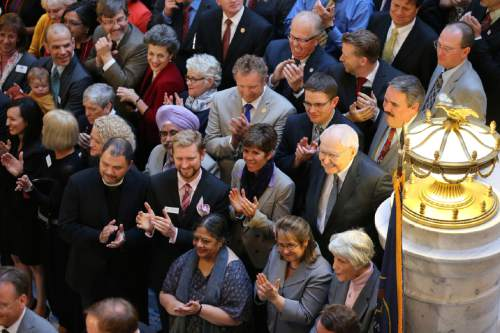 Courtesy  |  LDS Newsroom  Elder L. Tom Perry of the Quorum of the Twelve Apostles joins other supporters and community leaders as Utah Senate Bill 296 is signed into law.
