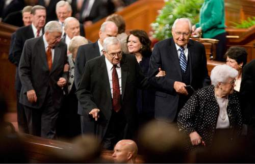 Jeremy Harmon  |  The Salt Lake Tribune  President Boyd K. Packer, center, is helped off the stand by Elder L. Tom Perry after the Saturday afternoon session of the 181st Semiannual General Conference of The Church of Jesus Christ of Latter-day Saints on Saturday, Oct. 1, 2011.