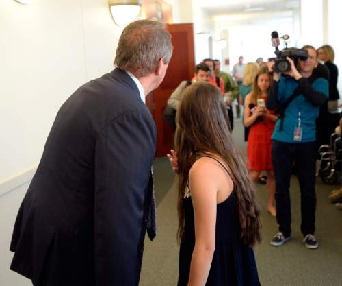 Al Hartmann |  The Salt Lake Tribune Former Utah Attorney General Mark Shurtleff waits with daughter Annie for his lawyer Richard Van Wagonner to finish speaking with the media in Salt Lake City Monday June 15 after his preliminary hearing.