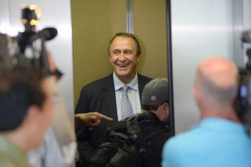 Al Hartmann |  The Salt Lake Tribune Former Utah Attorney General Mark Shurtleff,  laughs as media photographers climb aboard elevator with him at Matheson Courthouse after his prleiminary hearing in Salt Lake City Monday June 15.