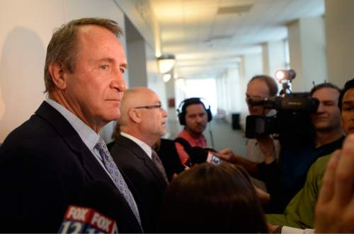 Al Hartmann |  The Salt Lake Tribune Former Utah Attorney General Mark Shurtleff, left, stands and remains silent as his attorney Richard Van Wagonner talks to the media outside Judge Randall Skanchy's courtroom in Salt Lake City Monday June 15 after a preliminary hearing.