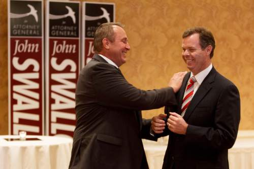 Trent Nelson  |  Tribune file photo Utah Attorney General Mark Shurtleff, left, and Republican attorney general nominee John Swallow share a laugh at a campaign event.