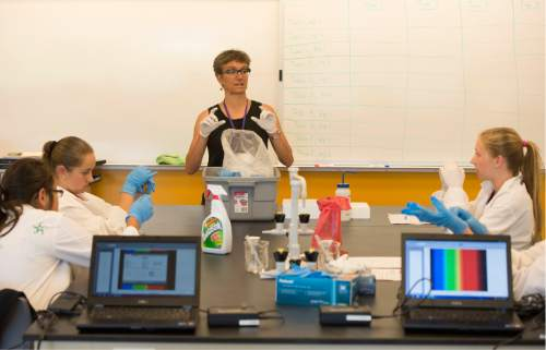 Rick Egan  |  The Salt Lake Tribune  Dr. Lisa Gentile talks instructs a class of eighth-grade girls at the AWE+SUM Summer Girls Camp at Westminster, Friday, June 19, 2015.