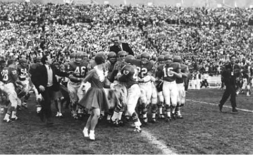 Photo courtesy of BYU  A memorable first in football annals at BYU was the Cougars'  first-ever win over Utah in Provo in 1965. Floyd Millet's and Hal Kopp's teams previously had beaten Utah in Salt Lake City, but Hudspeth's team pulled it off in Provo in 1965, and he was carried off the field on the shoulders of his players. The final score over the Utes was 25-20.
