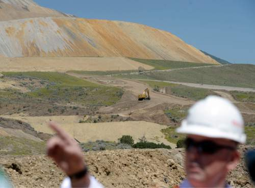 Al Hartmann |  The Salt Lake Tribune Rio Tinto's general manager of construction Michael Piercey points out the East Waste Rock Project that will stabilize and revegetate the bottom slope of a huge tailings pile at Kennecott.