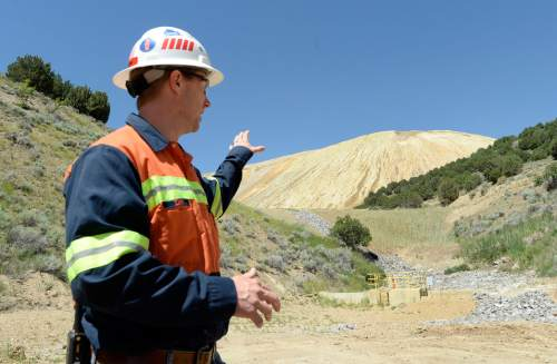 Al Hartmann |  The Salt Lake Tribune Zeb Kenyon, senior environmental advisor for Rio Tinto, points out the newly constructed waste dump and cut-off wall that stabilizes the bottom of the tailings pile and deals with runoff from large rain events.