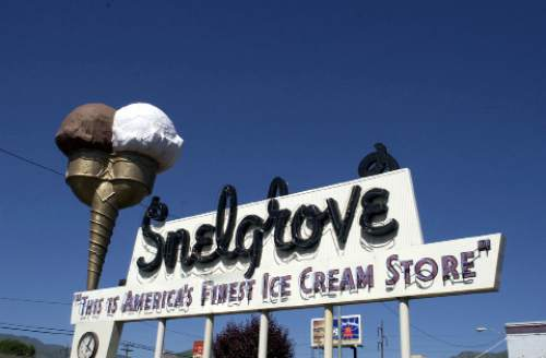 Trent Nelson  |  Tribune File Photo  The Snelgrove Ice Cream Parlor on 2100 South (between 800 and 900 East) closed in 2002. Although the ice cream cone atop its iconic sign stayed for more than 10 years, the buildin'gs current tenants, Dreyer and Nestle, will replace the sign to represent their company. The company has said it will refurbish the cone and it may even spin again. Photograph taken June 5, 2002.