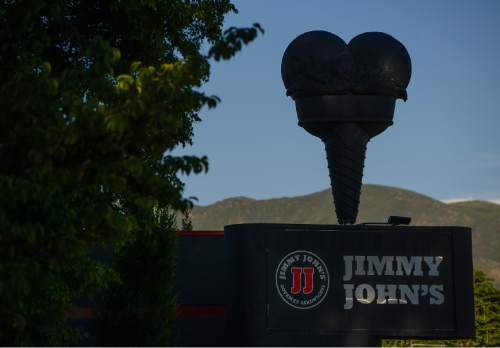 Francisco Kjolseth  |  The Salt Lake Tribune  Jimmy Johns on 400 South and 600 East in Salt Lake City dons the former Snelgrove ice cream come on its building. The store once sold the locally-made ice cream, but was painted black when Jimmy Johns moved in.