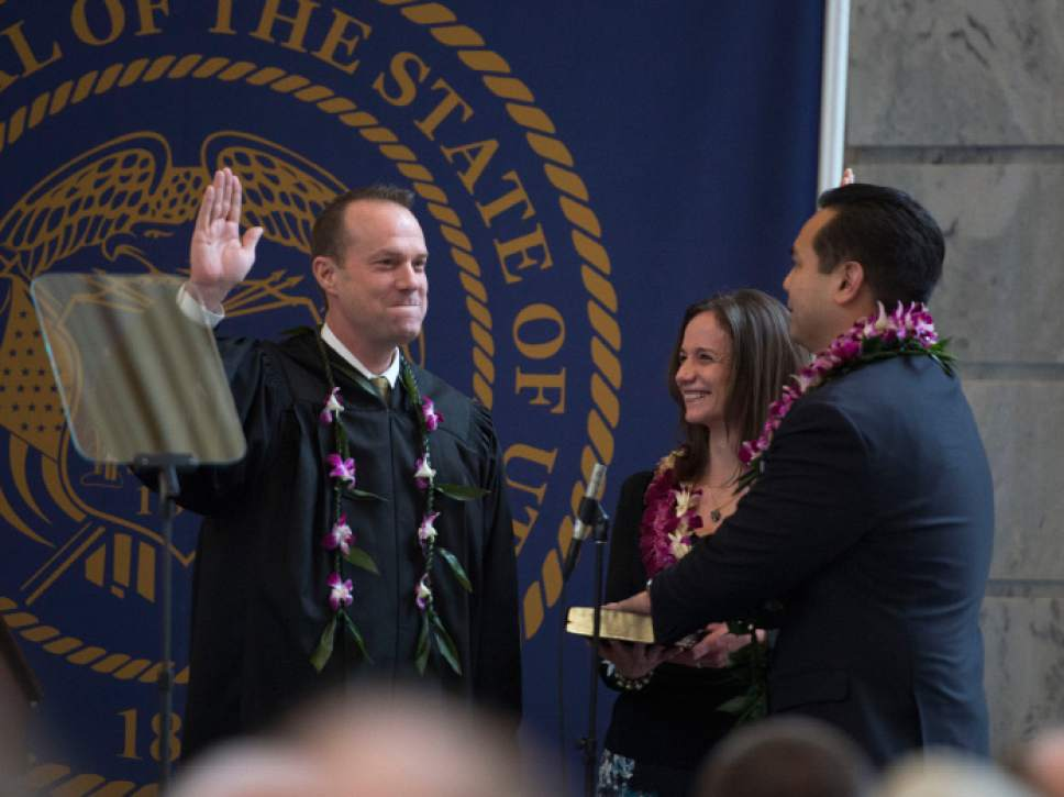 Steve Griffin     The Salt Lake Tribune   Attorney General Sean Reyes stands with his wife, Saysha, as he takes the oath of office administered by Utah Supreme Court  Justice Thomas R. Lee during his inaugural program in the Utah Capitol Rotunda in Salt Lake City, Monday, Jan. 5, 2015.