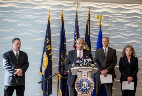 Trent Nelson  |  The Salt Lake Tribune The arrest of former Utah Attorneys General Mark Shurtleff and John Swallow is announced at an press conference at FBI headquarters in Salt Lake City, Tuesday July 15, 2014. Left to right are Davis County Attorney Troy Rawlings, Salt Lake County District Attorney Sim Gill, Public Safety Commissioner Keith Squires, Mary Rook, special agent in charge of the FBI office in Salt Lake City.