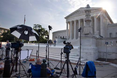 Television crews are set up outside of the Supreme Court in Washington, Thursday June 25, 2015. The court is expected to hand down decisions today. Two major opinions, health care and gay marriage, are among the remaining to be released before the term ends at the end of June. (AP Photo/Jacquelyn Martin)