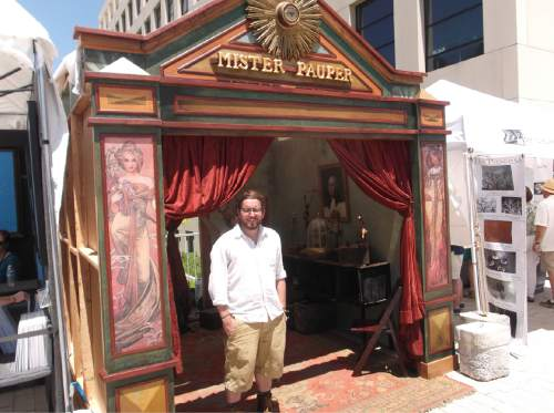Sean P. Means  |  The Salt Lake Tribune  Jake Buntjer, a k a Mister Pauper, a found-object artist from American Fork, Utah, stands Thursday in the elaborate frontage to his booth at the Utah Arts Festival in Library Square.