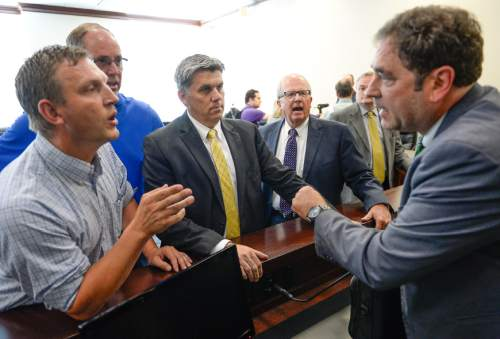 Francisco Kjolseth | The Salt Lake Tribune Conversation become a little heated as Iron County Commissioner Dave Miller, left, joined by Mark Whitney, San Juan County Commissioner Phil Lyman and Rep. Mike Noel, from left, speak with House Minority Leader Brian King, following a meeting by members of Utah's Constitutional Defense Council at the Capitol on Wednesday, June 24, 2015. Rep. Mike Noel tried to make a case for setting aside money for Phil Lyman's legal bills. In the end it was decided that money will be raised by private donations.