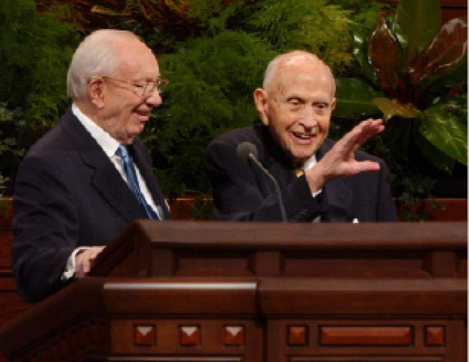 Rick Egan  |  Tribune file photo   President Gordon B. Hinckley invites Elder David B. Haight up to the podium to  wave to the crowd before excusing him from the meeting in the Saturday October 4, 2003, morning session of LDS General Conference.