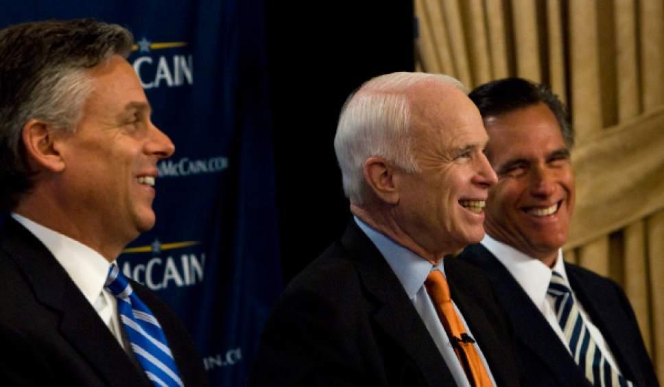 Steve Griffin  |  Tribune file photo  Sen. John McCain, R-Ariz., shares a laugh with Utah Gov. Jon Huntsman Jr., and former Massachusetts Gov. Mitt Romney, during a stop at the Grand America Hotel in Salt Lake City for a fundraiser.