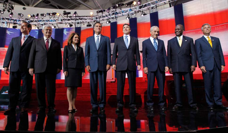 Chris Carlson  |  Associated Press file photo  Republican presidential candidates stand together before a Republican presidential candidate debate at the Reagan Library in Simi Valley, Calif.