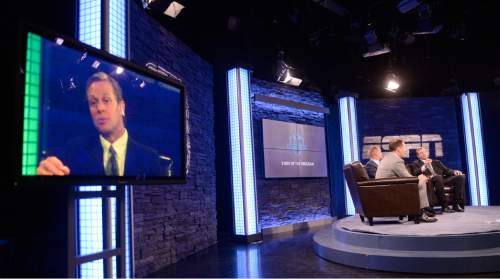 Al Hartmann |  The Salt Lake Tribune BYU TV's Dave McCann interviews BYU Athletic Director Tom Holmoe and BYU Head Football Coach Bronco Mendenhall on live TV program Tuesday June 24 for BYU football media day in Provo.