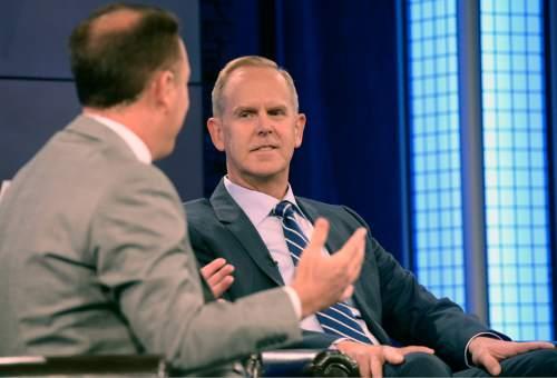 Al Hartmann |  The Salt Lake Tribune BYU TV's Dave McCann, left, interviews BYU Athletic Director Tom Holmoe on live TV program Tuesday June 24 for BYU football media day in Provo.