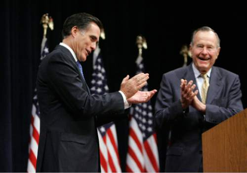 Republican presidential hopeful, former Massachusetts Gov. Mitt Romney, left, is introduced by former president George H.W. Bush, Thursday, Dec. 6, 2007, prior to speaking at the George Bush Presidential Library and Museum in College Station, Texas(AP Photo/LM Otero)