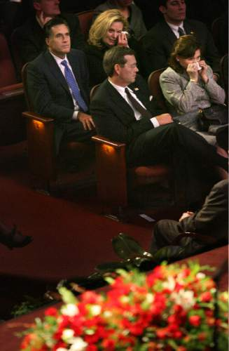 Scott Sommerdorf  |  Tribune file photo Presidential candidate Mitt Romney (upper left) sits next to his wife, Ann, who along with Michael Leavitt's wife Jackie (lower right), are crying during President Gordon B. Hinckley's funeral held at the LDS Conference Center Saturday, Feb. 2, 2008. President Hinckley's casket is in the foreground.