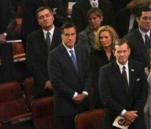 Scott Sommerdorf  |  Tribune file photo U.S. Representative Jim Matheson (upper left), Presidential candidate Mitt Romney and his wife Ann, and former Utah Governor, and current Health and Human Services Director Michael Leavitt stand at the funeral of LDS President Gordon B. Hinckley Saturday Feb. 2, 2008.