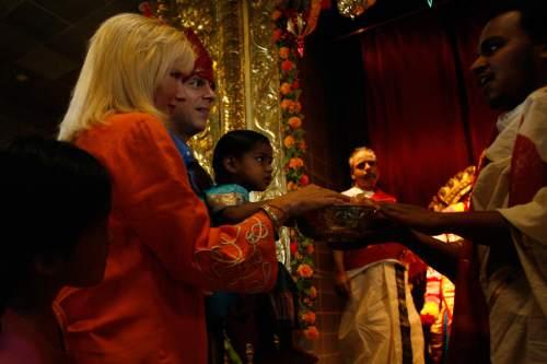 Chris Detrick |  Tribune file photo Priest Satish Kumar of the Sri Ganesha Hindu Temple of Utah blesses Gov. Jon Huntsman Jr., First Lady Mary Kaye, Asha and Gracie Mei Huntsman during a celebration in 2008.