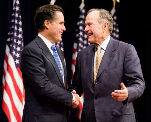 "Mitt Romney, left, former governor of Massachusetts and 2008 Republican presidential candidate, shakes hands with former U.S. President George H.W. Bush, right, before giving a  speech titled ""Faith in America"" at the George H.W. Bush Presidential Library in College Station, Texas, U.S., on Thursday, Dec. 6, 2007. Romney told the audience that there should be no religious test for the presidency and those who question his beliefs violate the spirit of the country's founding. Photographer: Paul Zoeller/Bloomberg News"
