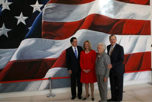 Republican presidential hopeful, former Massachusetts Gov. Mitt Romney, left, and his wife Ann, second from left, pose for photos with former President George H.W. Bush, right, and his wife Barbara, Thursday, Dec. 6, 2007,  at the George Bush Presidential Library and Museum at College Station, Texas.    (AP Photo/LM Otero)