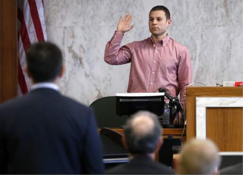 Benjamin Unger is sworn in as a witness in the trial against Jews Offering New Alternatives for Healing, (JONAH) Wednesday, June 3, 2015, in Jersey City, N.J. The nonprofit New Jersey based group, who promised to turn gays heterosexual with so-called gay conversion therapy, are being sued by Unger and three other plaintiffs for fraud.  (Alex Remnick/The Star-Ledger via AP,  Pool)