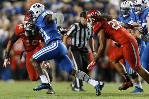 Trent Nelson  |  The Salt Lake Tribune Brigham Young Cougars running back Jamaal Williams (21) runs the ball in the second quarter as the BYU Cougars host the Utah Utes, college football Saturday, September 21, 2013 at LaVell Edwards Stadium in Provo.