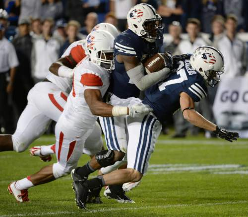 Steve Griffin  |  The Salt Lake Tribune   BYU Cougars running back Jamaal Williams (21) runs into teammate BYU Cougars wide receiver Mitchell Juergens (87) as the Houston defense drags him down in the second half of the  game between BYU and Houston and LaVell Edwards Stadium in Provo, Thursday, September 11, 2014.