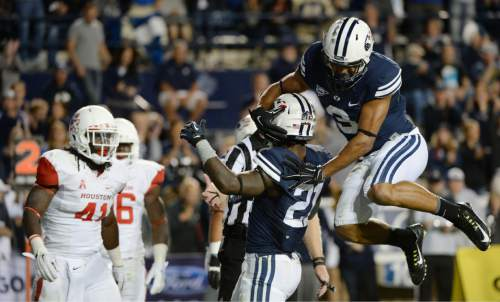 Steve Griffin  |  The Salt Lake Tribune   BYU Cougars wide receiver Colby Pearson (3) leaps onto BYU Cougars running back Jamaal Williams (21) after Williams scored a touchdown in the second half of the  game between BYU and Houston and LaVell Edwards Stadium in Provo, Thursday, September 11, 2014.