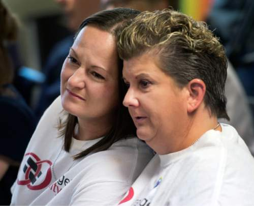 Steve Griffin  |  The Salt Lake Tribune   Jolene and Colleen Newing, who were married in Utah Dec. 23, 2013, hug as they listen during a press conference at the Utah Pride Center in response to the US Supreme Court marriage equality ruling granting full marriage equality across the United States at the Utah Pride Center in Salt Lake City, Friday, June 26, 2015.