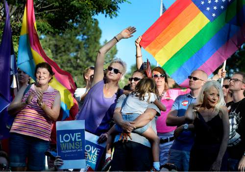 Scott Sommerdorf   |  The Salt Lake Tribune Some of the hundreds of participants cheer at a rally in City Creek Park to celebrate the SCOTUS ruling, Friday, June 26, 2015.