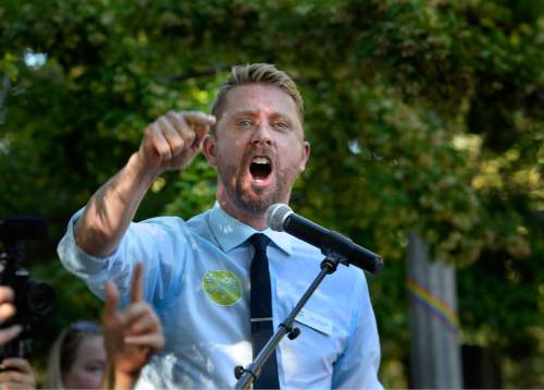 Scott Sommerdorf   |  The Salt Lake Tribune Troy Williams speaks at a rally in City Creek Park to celebrate the SCOTUS ruling, Friday, June 26, 2015.