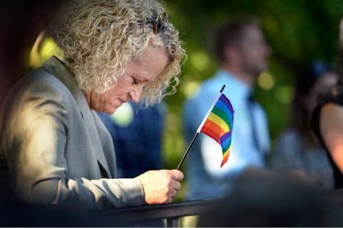 Scott Sommerdorf   |  The Salt Lake Tribune Mayoral candidate Jackie Biskupski pauses as it's mentioned during a speech that those activists who came before deserve to be remembered at this time. She listened to speeches at a rally in City Creek Park to celebrate the SCOTUS ruling, Friday, June 26, 2015.