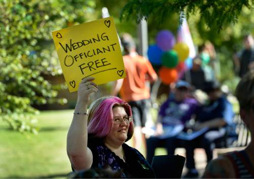 Scott Sommerdorf   |  The Salt Lake Tribune A woman advertises her wedding services at a rally in City Creek Park to celebrate the SCOTUS ruling, Friday, June 26, 2015.