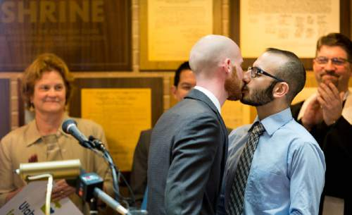 Trent Nelson     The Salt Lake Tribune Derek Kitchen and Moudi Sbeity kiss after speaking at a press conference announcing a public education campaign, Utah Unites for Marriage, in Salt Lake City, Tuesday, March 18, 2014.