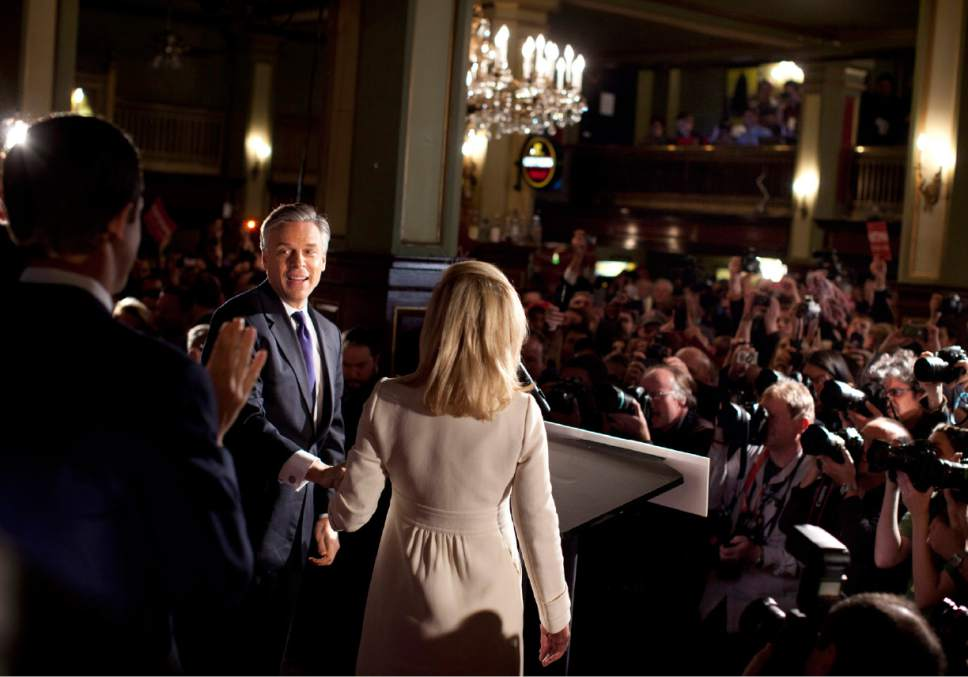 Republican presidential candidate, former Utah Gov. Jon Huntsman is seen on stage at a primary election night rally Tuesday, Jan. 10, 2012 in Manchester, N.H.  (AP Photo/Evan Vucci)
