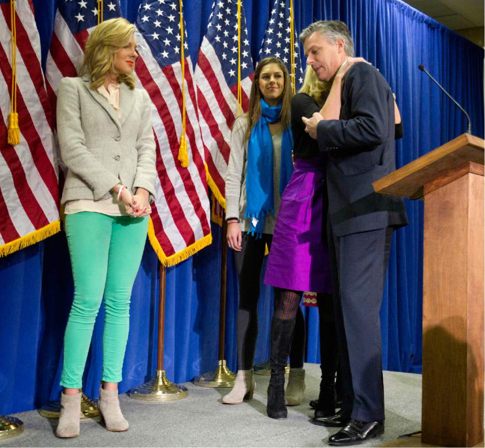 Republican presidential candidate former Utah Gov. Jon Huntsman, right, is embraced by his wife Mary Kaye, as daughters Mary Anne, left, and Abby look on after Huntsman announced his withdraw from the race, Monday, Jan. 16, 2012, in Myrtle Beach, S.C. (AP Photo/David Goldman)