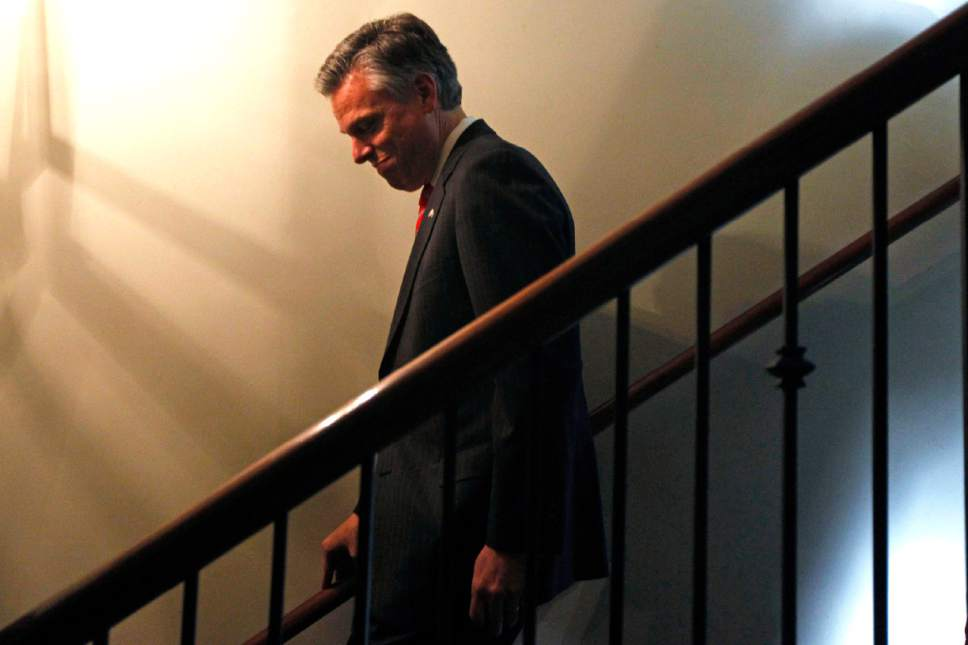 Republican presidential candidate former Utah Gov. Jon Huntsman descends stairs during an event at Virginia's on King restaurant, Sunday, Jan. 15, 2012, in Charleston, S.C. Huntsman will withdraw Monday, Jan. 16 from the race for the Republican presidential nomination. Campaign officials tell The Associated Press Huntsman will endorse Mitt Romney at an event in South Carolina on Monday morning. (AP Photo/Matt Rourke)