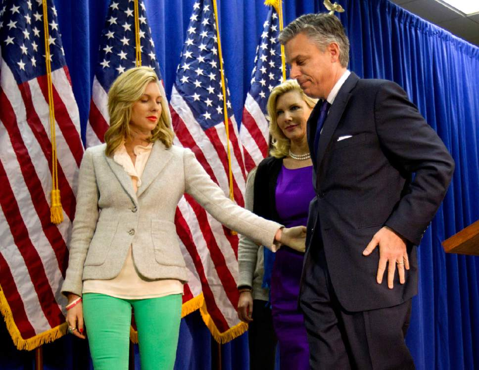 Mary Anne Huntsman, left, grabs the hand of her father, Republican presidential candidate, former Utah Gov. Jon Huntsman, as they walk off stage with wife Mary Kaye, after announcing his withdraw from the race and endorsement for former Massachusetts Gov. Mitt Romney, Monday, Jan. 16, 2012, in Myrtle Beach, S.C. (AP Photo/David Goldman)