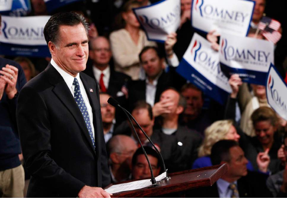 Republican presidential candidate, former Massachusetts Gov. Mitt Romney, celebrates his New Hampshire primary election win in Manchester, N.H., Tuesday, Jan. 10, 2012. (AP Photo/Charles Dharapak)
