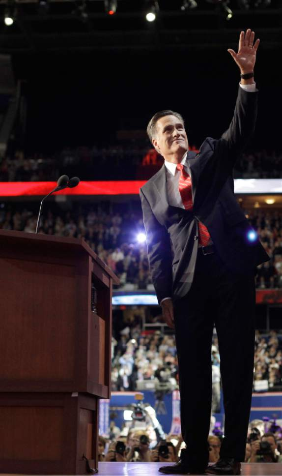 Republican presidential nominee Mitt Romney waves to delegates before speaking at the Republican National Convention in Tampa, Fla., on Thursday, Aug. 30, 2012.  (AP Photo/David Goldman)
