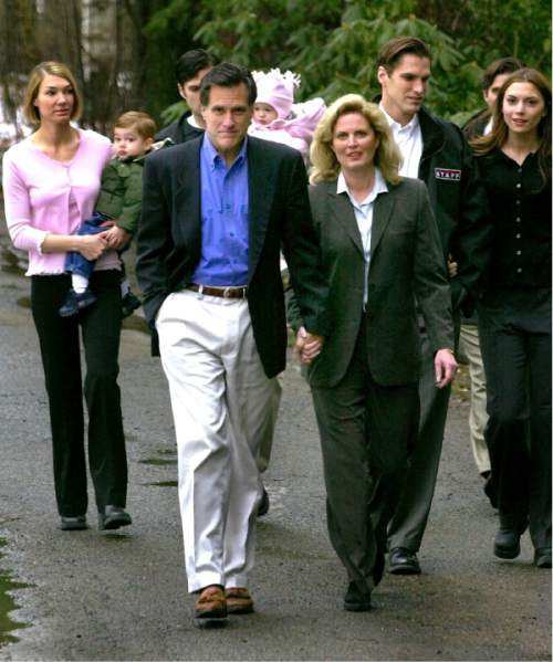 Mitt Romney holds hands with his wife Ann, as his family follows down the driveway of his home  in Belmont, Mass., Tuesday, March 19, 2002 as he approached reporters to discuss his plans to run as a Republican for Massachusetts governor.  Earlier in the day acting-Governor Jane Swift announced that she would quit her race for the office.  Romney expected to make the formal announcement of his candidacy at an event later in the day, but postponed the event in respect of Swift's decision not to run.  Romney, 55, has been riding a wave of popularity since successfully leading last month's Winter Olympics. (AP Photo/Charles Krupa)