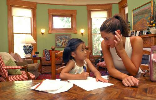 Francisco Kjolseth  |  The Salt Lake Tribune  Governor Jon Huntsman Jr.'s daughters Gracie Mei, 6, and Abby, 19, discuss the colors of the rainbow while the two hang out on the family dining room table at the governor's mansion in Salt Lake on July 26, 2005.