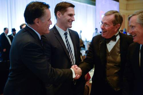 Franciso Kjolseth  |  The Salt Lake Tribune  Mitt Romney, left, alongside his son Josh meets with former Gov. Mike O. Leavitt moments before The Salt Lake Chamber was to honor Leavitt with the business honor A Giant in Our City on Thursday, April 10, 2014, at the Grand America Hotel. Former presidential nominee Mitt Romney was the keynote speaker.