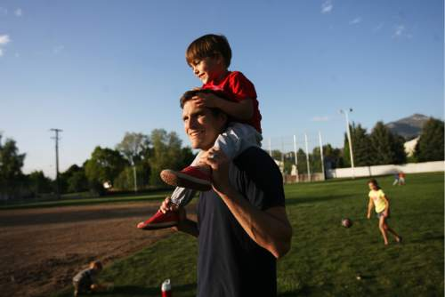 Kim Raff | The Salt Lake Tribune  Josh Romney with his son Nash Romney on top of his shoulders as the family spends time together at another son's baseball practice at an LDS stake house in Holladay, Utah on May 3, 2012.